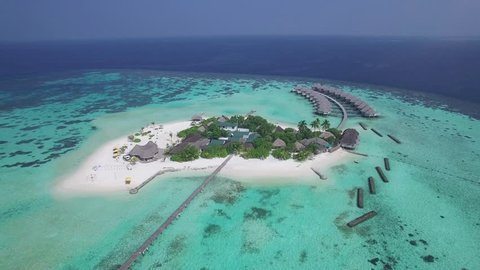 4k aerial video, bird eye view, drone fly over the Maldives islands. Small tropical island. Islands in the ocean. Palm. Ocean. Sky. White sand. Beach. Waves. Island. Islands. Tropics.