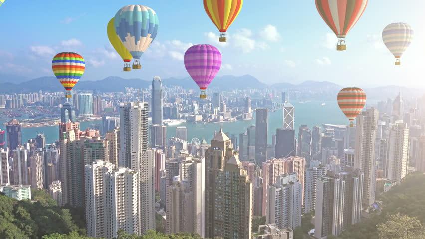 4K Group of Colorful Hot Air Balloons Fly over Hong Kong