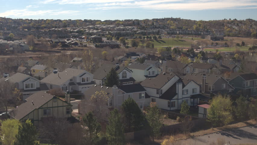 aerial close up: flying above the rooftops of new modern expensive