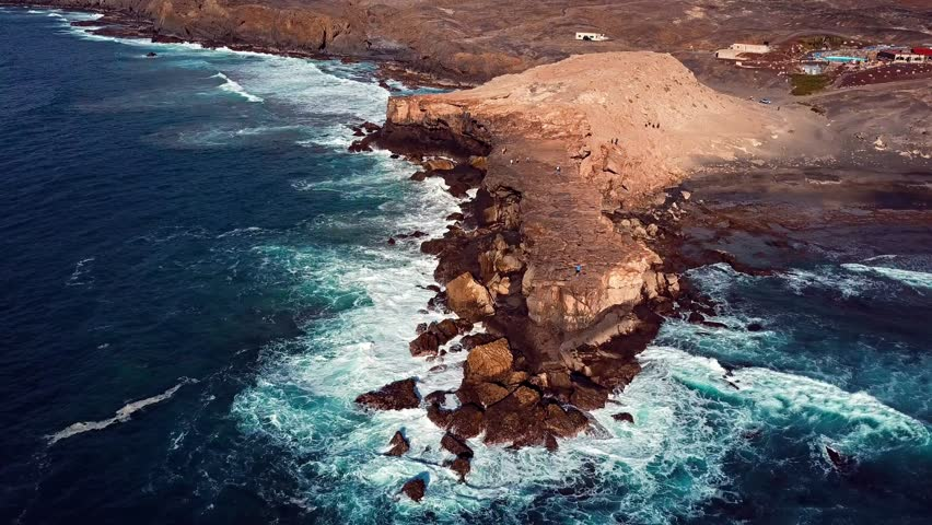 Flying over cliff in La Pared, Fuerteventura, Canary Islands. #25770419
