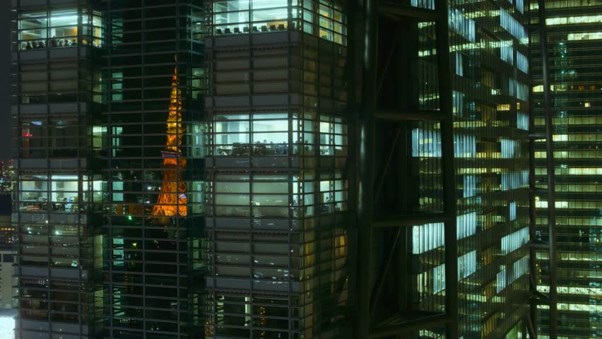 tokyo business center night view time lapse with famous tokyo tower reflecting in windows #25780619