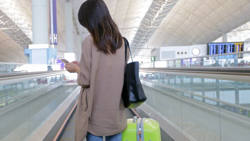 Back rear view of woman going to airport | Shutterstock HD Video #25817759