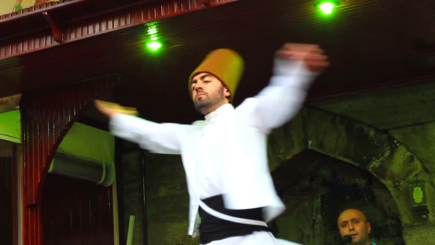 ISTANBUL - JULY 25: Sufi whirling dervish (Semazen) dances at Sultanahmet during holy month of Ramadan on July 25, 2012 in Istanbul. Semazen conveys God's spiritual gift to those are witnessing ritual