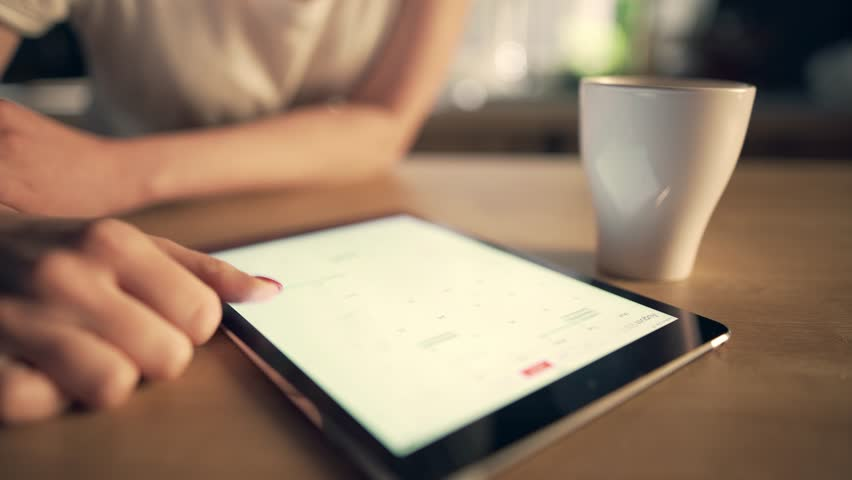 Woman using tablet and drinking coffee | Shutterstock HD Video #25830989