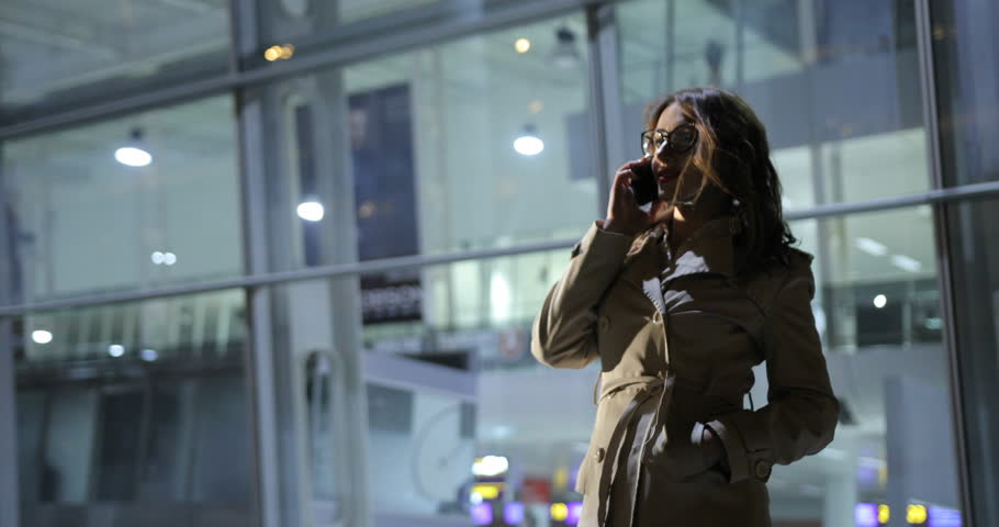 Beautiful woman is making a phone call, outdoors in the city at night.   Shutterstock HD Video #25833239