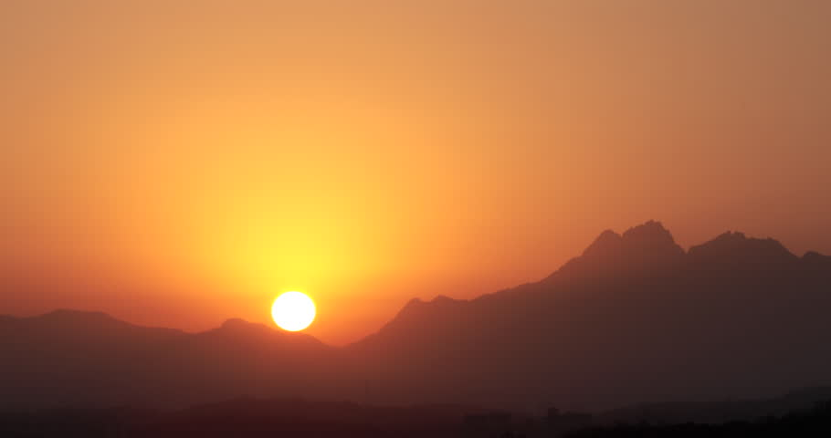 Time lapse of rising sun over mountain : 4K footage  | Shutterstock HD Video #25842809
