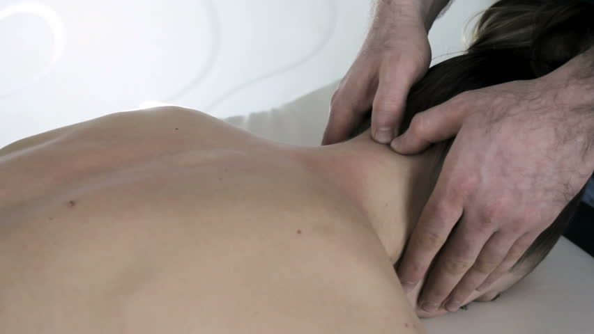 The young girl on reception at doctor chiropractor, cervical spine analysis