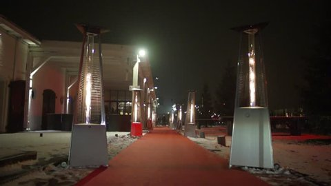 Slow walk on red carpet to night venue entrance