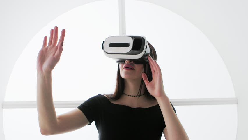 Young Woman in Virtual Reality Glasses. VR. Google cardboard. VR. Google cardboard