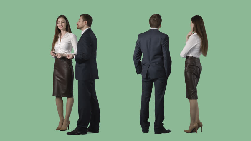 Business man and elegant female are standing, looking at something, discussing. Alpha channel. Two videos at one price
