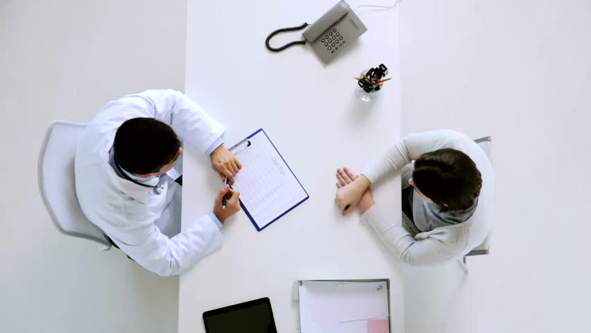 Medicine, healthcare, dietology and people concept - doctor with diet chart on clipboard and young patient woman meeting at hospital | Shutterstock HD Video #25859759
