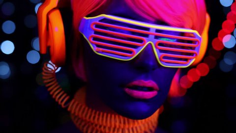 4k fantastic video of sexy cyber raver woman filmed in fluorescent clothing under UV black light