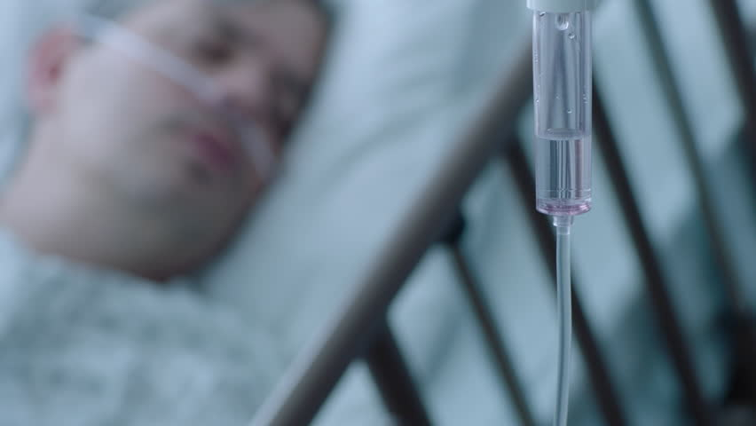 A sick middle aged man with an IV drip recovering in a hospital bed, slow motion, 4K | Shutterstock HD Video #25907837