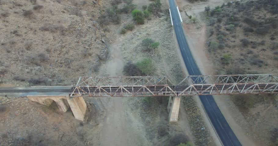 Aerial drone video with view of old railway bridge, set on main B6 road from Windhoek to Gobabis and Windhoek International Airport in central highland Khomas Hochland of Namibia, southern Africa