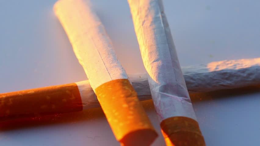 Tobacco cigarettes up close rotating | Shutterstock HD Video #25926515