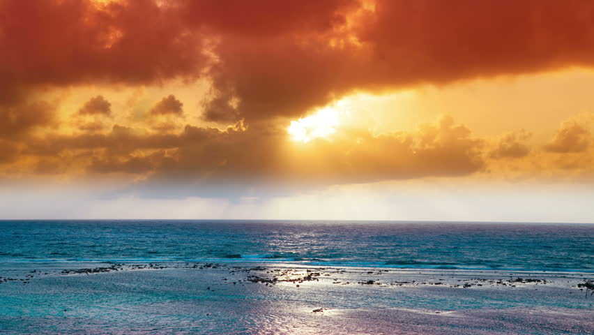 timelapse of a beautiful sunset over the caribbean sea, mexico. this version has been heavily filtered ink post to make a dreamy fantasy feel.