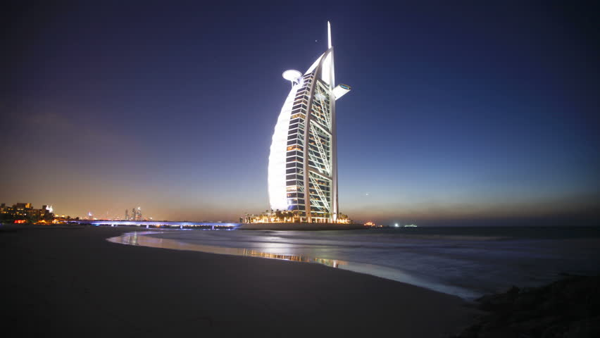 DUBAI, UNITED ARAB EMIRATES - CIRCA MAY 2011: transition from dusk to night showing the illumination on the modern elegantly designed Burj Al Arab Hotel.