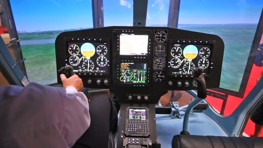 Pilot operates helicopter simulator on exhibition of helicopter industry