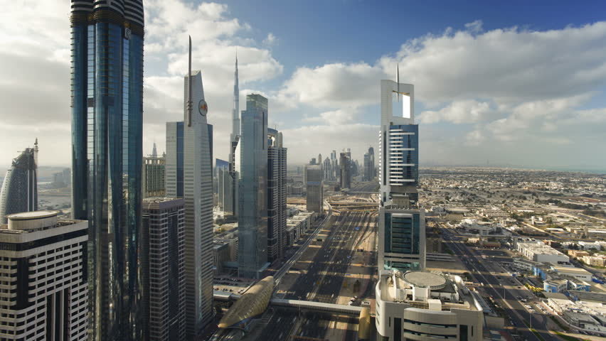 DUBAI, UNITED ARAB EMIRATES - CIRCA MAY 2011: timelapse over Sheikh Zayed Rd, showing the new MTR track and station system and the Burj Khalifa.