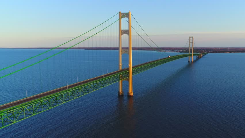 Spanning the very heart of the Great Lakes, stands an engineering marvel and a vast structure of ethereal beauty, a bridge to rival the Golden Gate. This is the Mackinac Bridge, #25963343