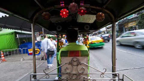 BANGKOK, THAILAND - CIRCA MAY 2011: Time Lapse of a Speeding Rickshaw on the busy streets