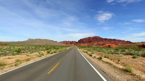 Incredibly beautiful landscape in Southern Nevada, Valley of Fire State Park, USA. Smooth camera movement along the road.