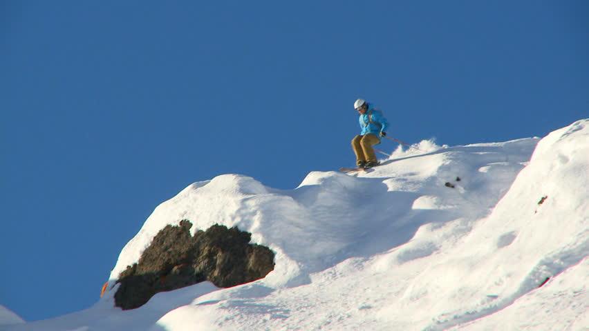 Male skier carving through steep terrain | Shutterstock HD Video #2602439