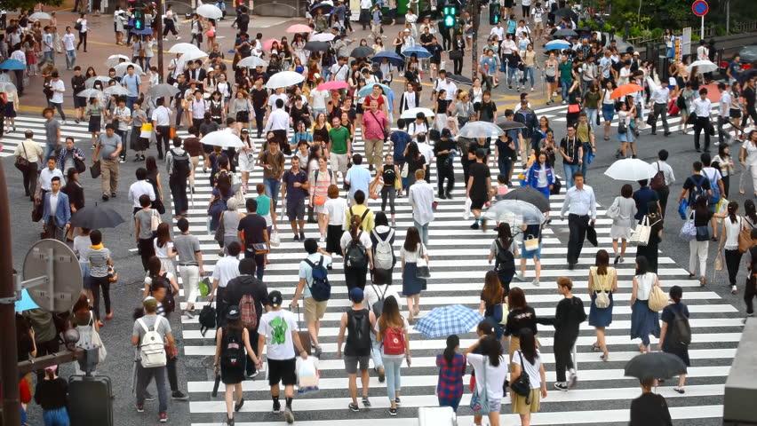 Tokyo, Japan - August 30, 2016: People on famous Shibuya Crossing. Crowd walking across the road on pedestrian crossing #26043959