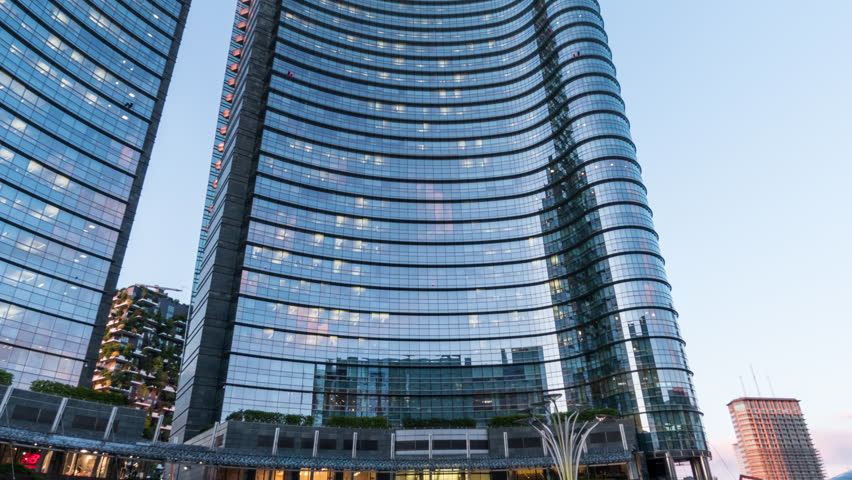 MILAN, ITALY / APRIL 15, 2017: New Porta Nuova financial district with the Unicredit tower in Gae Aulenti square at sunset