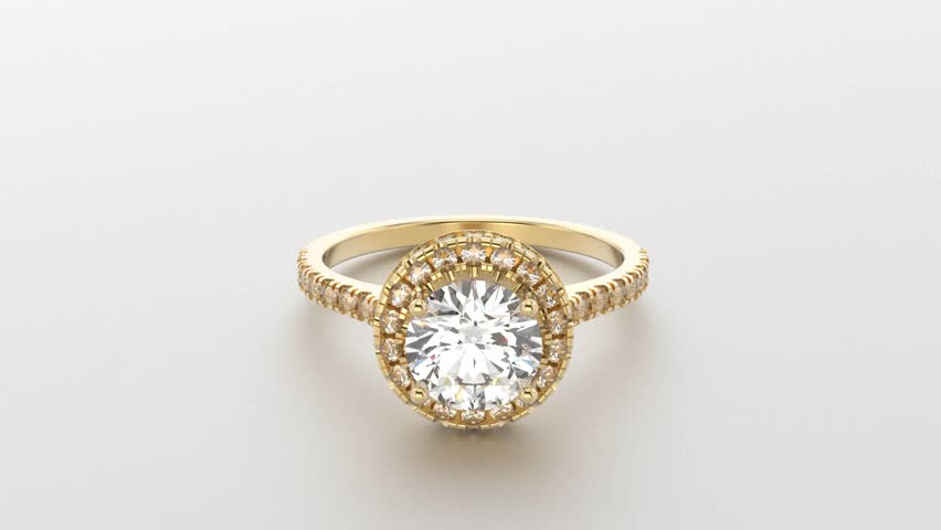 Rotating Gold Ring With A Diamond Closeup Stock Footage Video