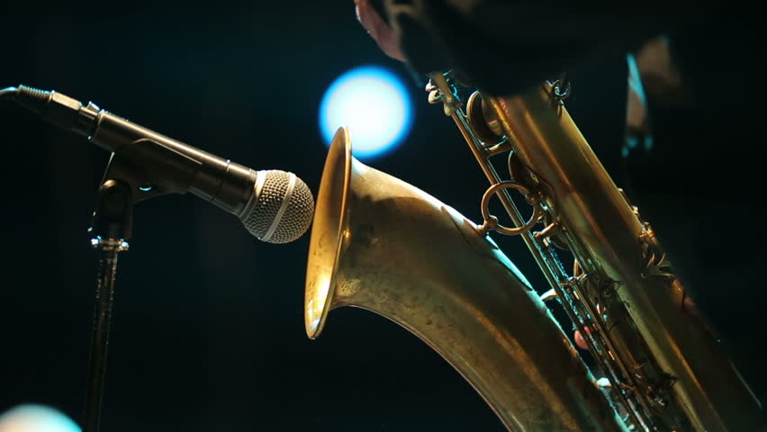 Saxophonist play on golden saxophone. Live performance. Jazz music. stage