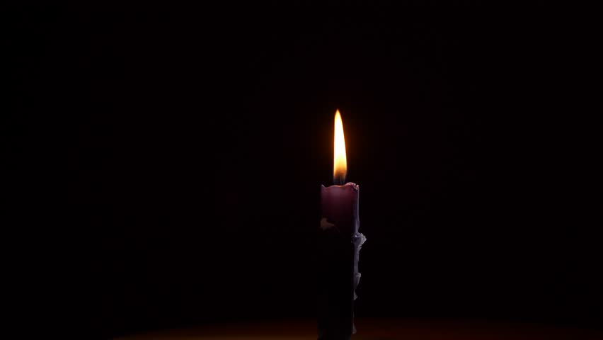 Candle Burning Yellow Flame In Hand, On A Black Background ...