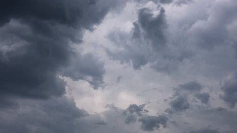 dark storm clouds are moving fast at viewer, timelapse, 4k