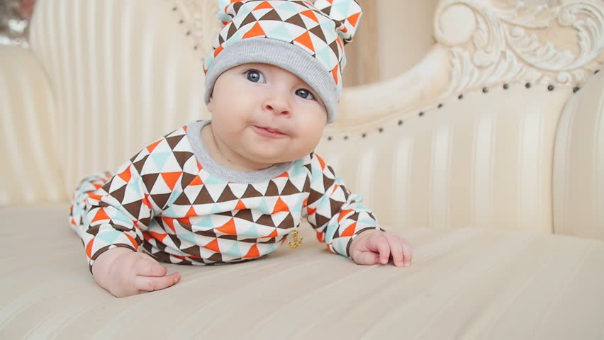 Baby lies on the bed and smiles | Shutterstock HD Video #26121659
