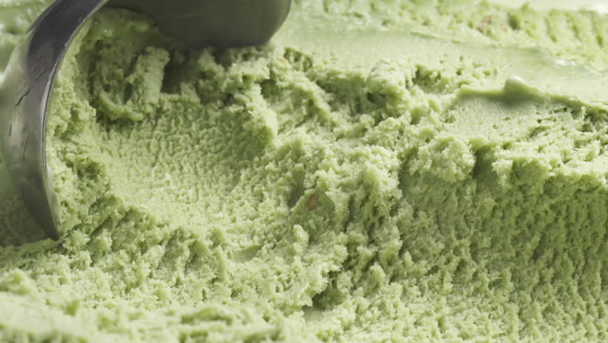 Slow motion of pistachio ice cream being scooped close up, 180fps prores footage
