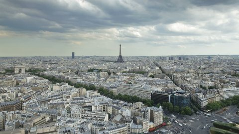 Aerial view of the City of Paris with the Eiffel Tower in the distance on a cloudy day
