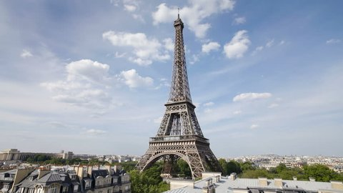 The world famous Eiffel Tower in natural light and some clouds, Paris, France