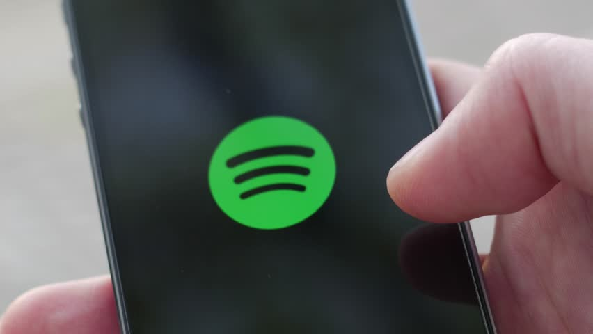PARIS, FRANCE, APRIL 2017 - Spotify music app browsing from a smartphone device 2160p 4K UHD stock video