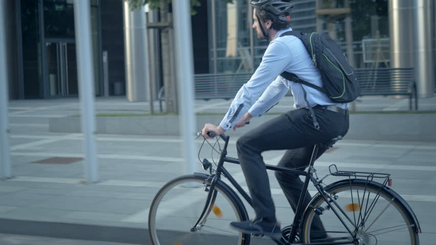 Confident male worker in shirt with a backpack commuting to a job. Smart handsome cyclist traveling by sustainable transport and living a healthy lifestyle. | Shutterstock HD Video #26214935