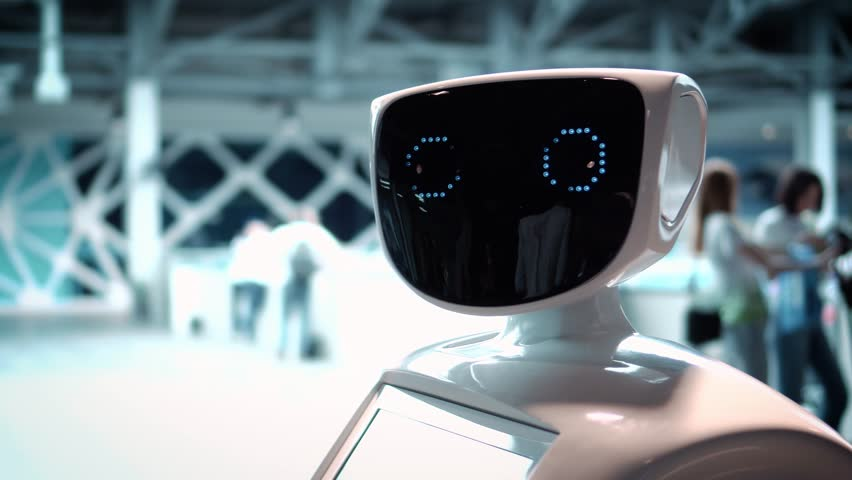 Modern Robotic Technologies. The robot looks at the camera at the person. The robot shows emotions. Raises his hands up, dances or is indignant. Or attacks | Shutterstock HD Video #26223152
