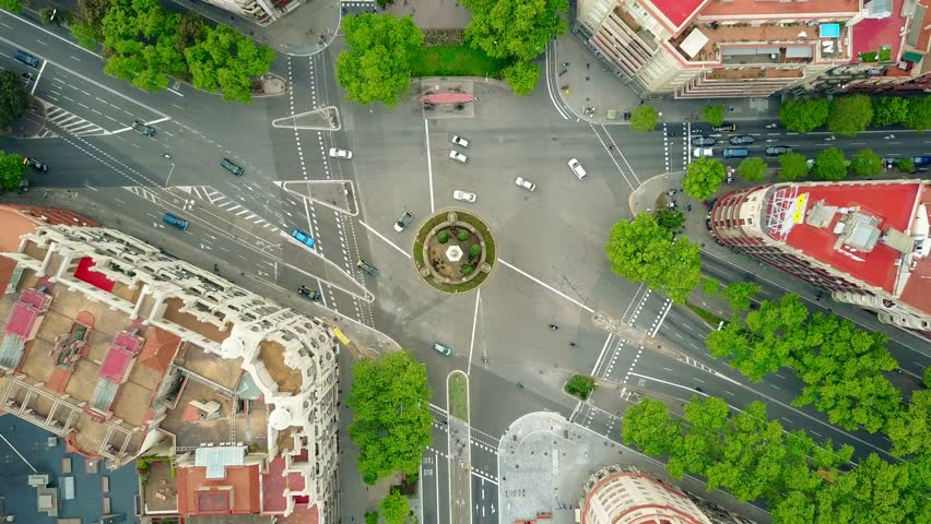 Roundabout in Barcelona, aerial rising shot, top view. 4K video