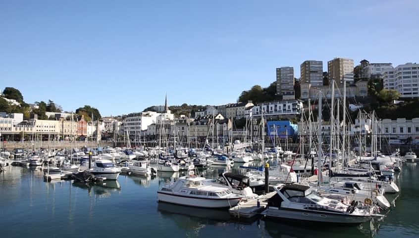 Torquay Devon UK marina with boats and yachts on beautiful day on the English Riviera pan