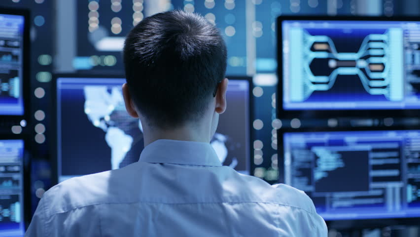 In the Monitoring Room Team of System Engineers Working at Their Workstations. Multitple Displays Show Various Important Data and Information. Possible Air Traffic/ Power Plant/ Security Room Theme. | Shutterstock HD Video #26262959
