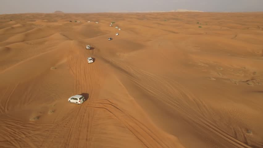 4K Aerial View Of Sports Cars Dune Bashing in Dubai #26272109