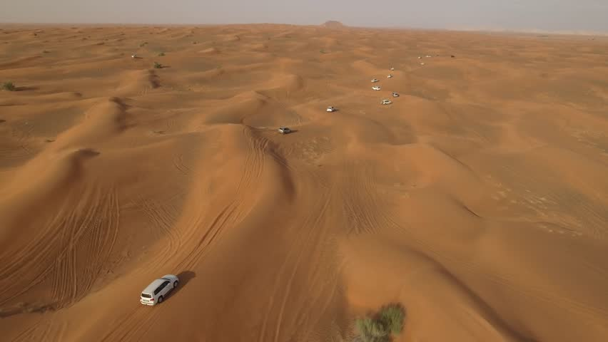 4K Aerial View Of Sports Cars Dune Bashing in Dubai #26272139