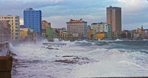storm waves crashing on malecon, havana, cuba