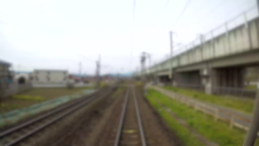 4K.Time lapse Blur Moving Railroad tracks, train passing through countryside Fukushima province in Japan