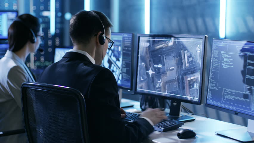 In Government Agency System Surveillance Center Employees Trace Criminal with Help of GPS. Their Room is Full of Displays with Various Data on Them. Shot on RED EPIC-W 8K Helium Cinema Camera. | Shutterstock HD Video #26395259