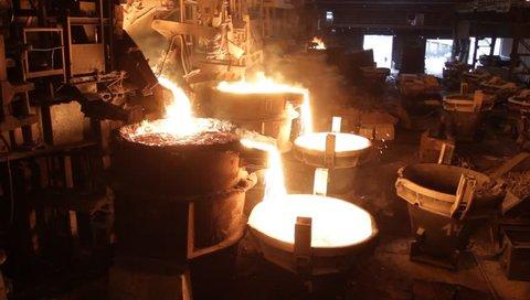 Steel production. Steel Workshop. Liquid steel. Lava. Fluid metal. Shop. Dirty work. Hard work. Molten metal. Stock. Casting mold. Heat resistant. Factory. Forge Melting. Steel texture.