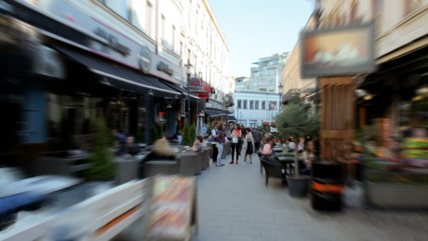 Accelerated Shooting of Tourist Busy Street with Cafe and Crowds of People in Bucharest, Capital of Romania